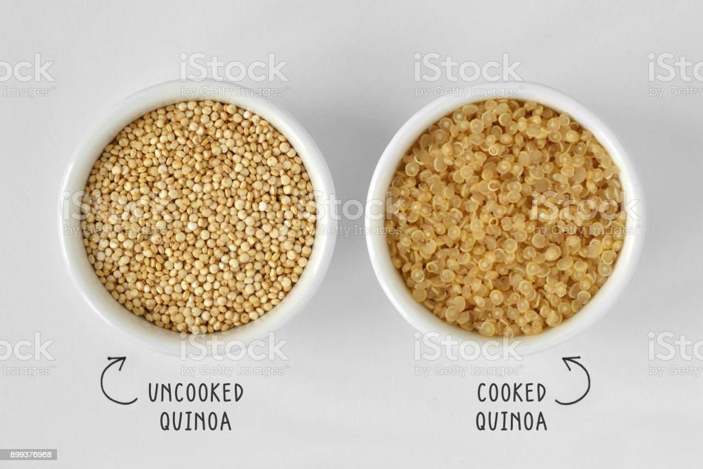 Cooked and uncooked quinoa stock photo