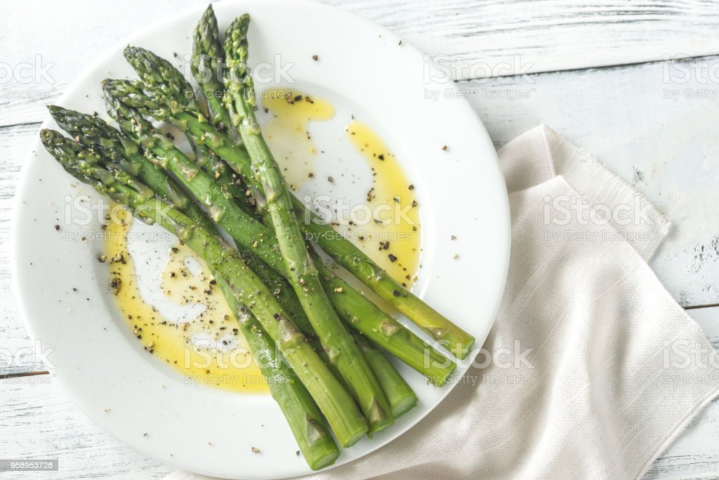 Cooked asparagus on the plate royalty-free stock photo