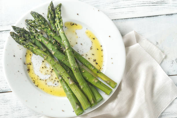 cooked asparagus on the plate - asparagus stock pictures, royalty-free photos & images