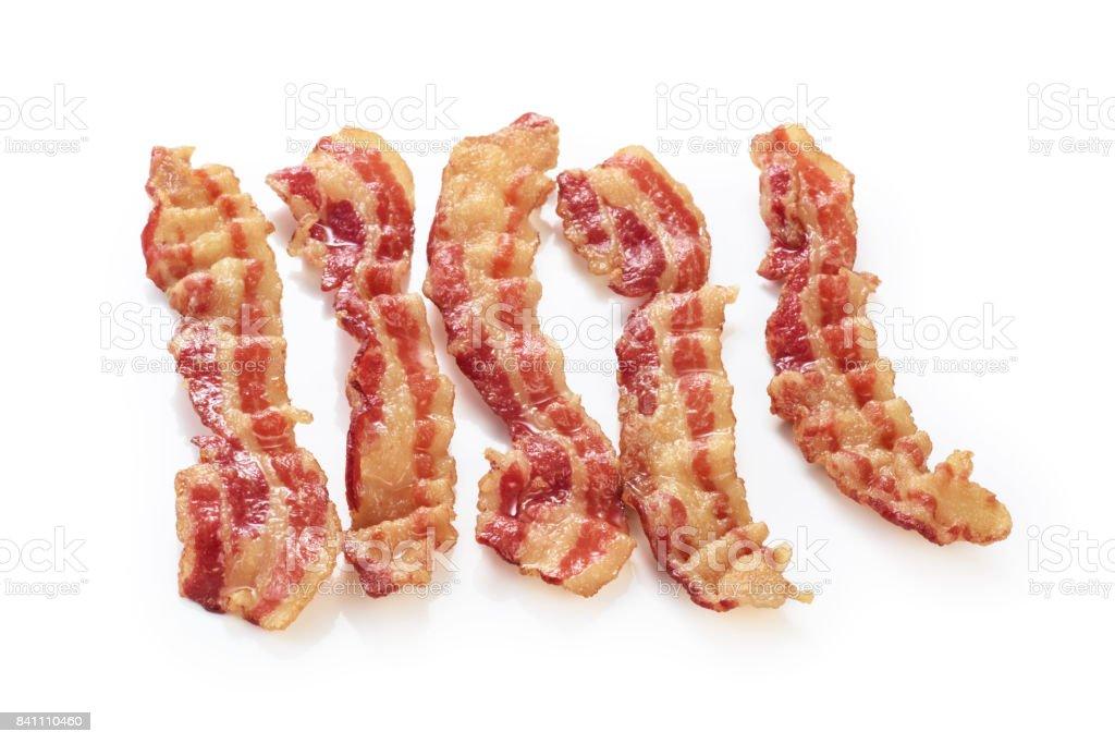 Cooked bacon rashers isolated on white background stock photo