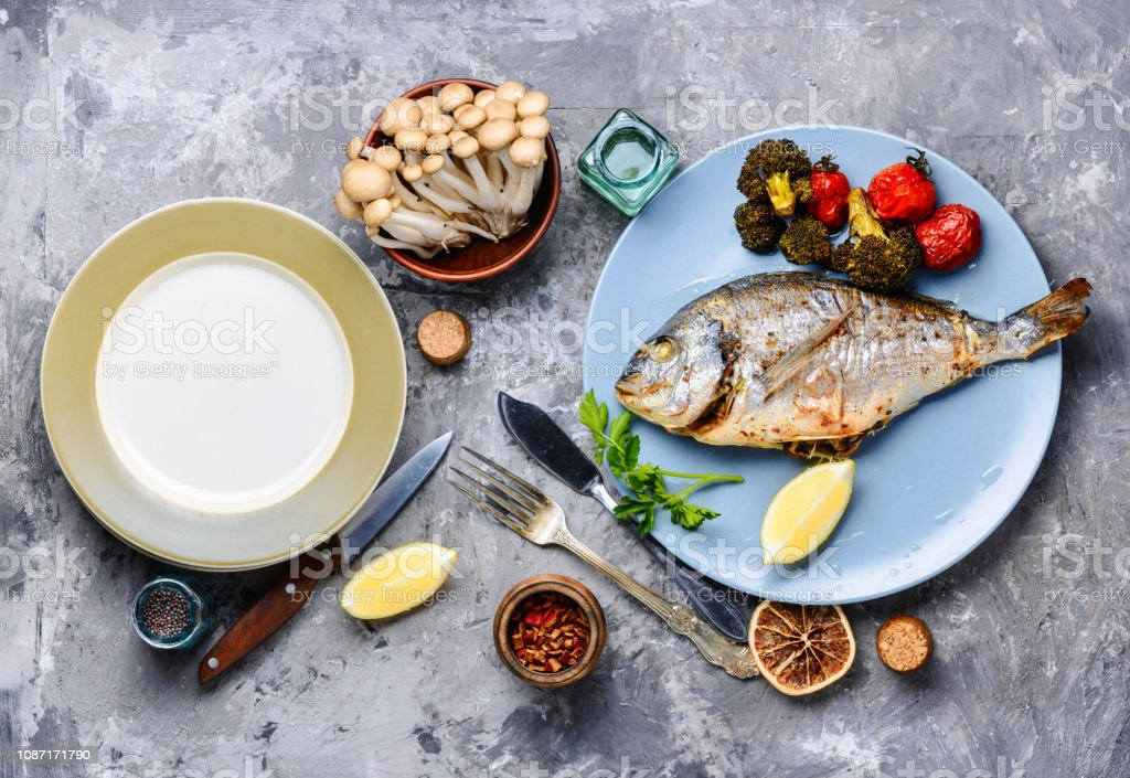 Cooked baked grilled fish stock photo