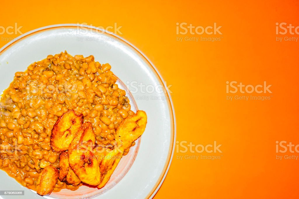 Cooked Bean with Fried Plantain stock photo
