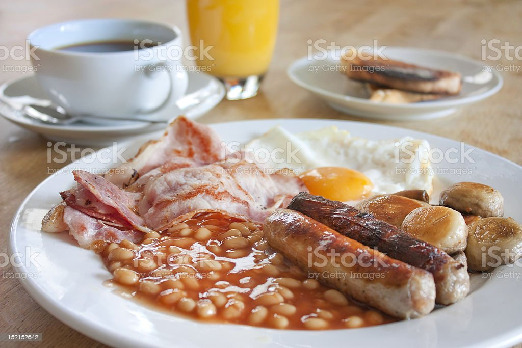 cooked breakfast on a wooden table stock photo