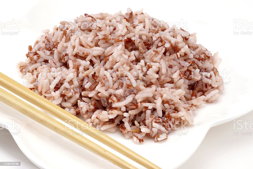 Cooked Brown Rice on white plate stock photo