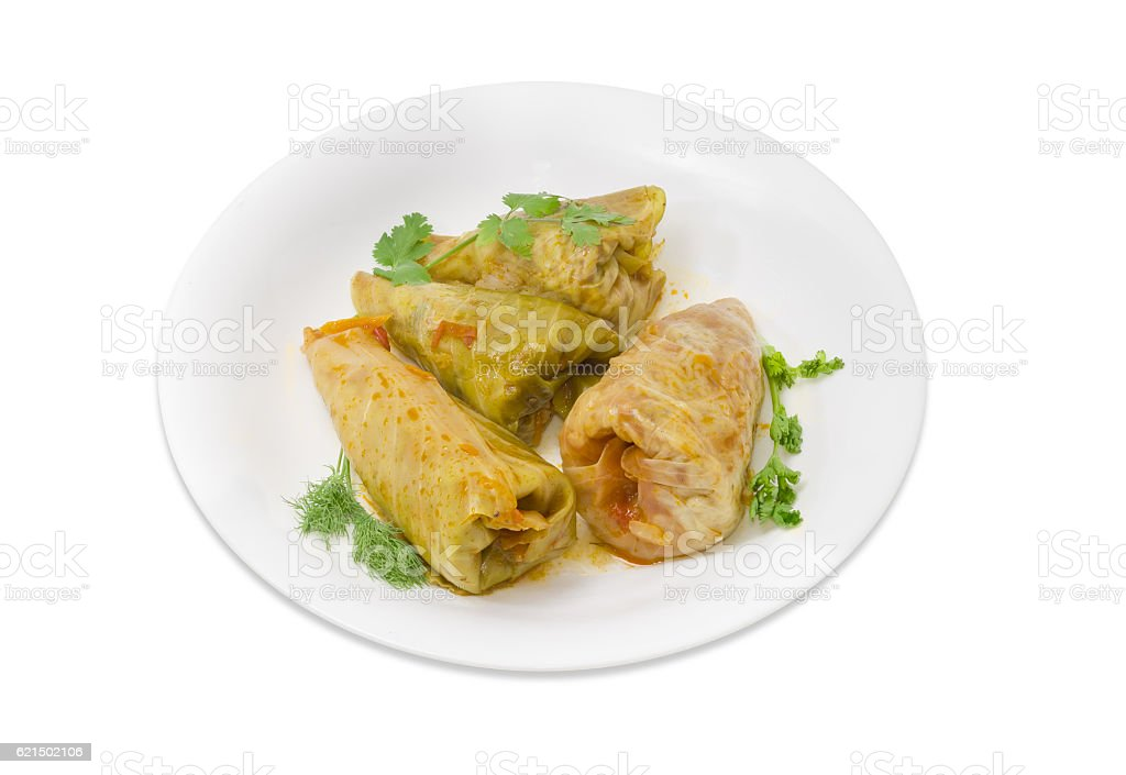 Cooked cabbage rolls and twigs of greenery on white dish Lizenzfreies stock-foto