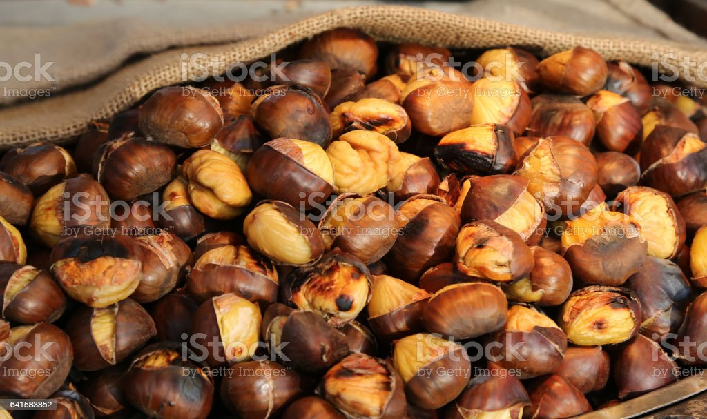 cooked chestnuts for sale in the stall in the street stock photo