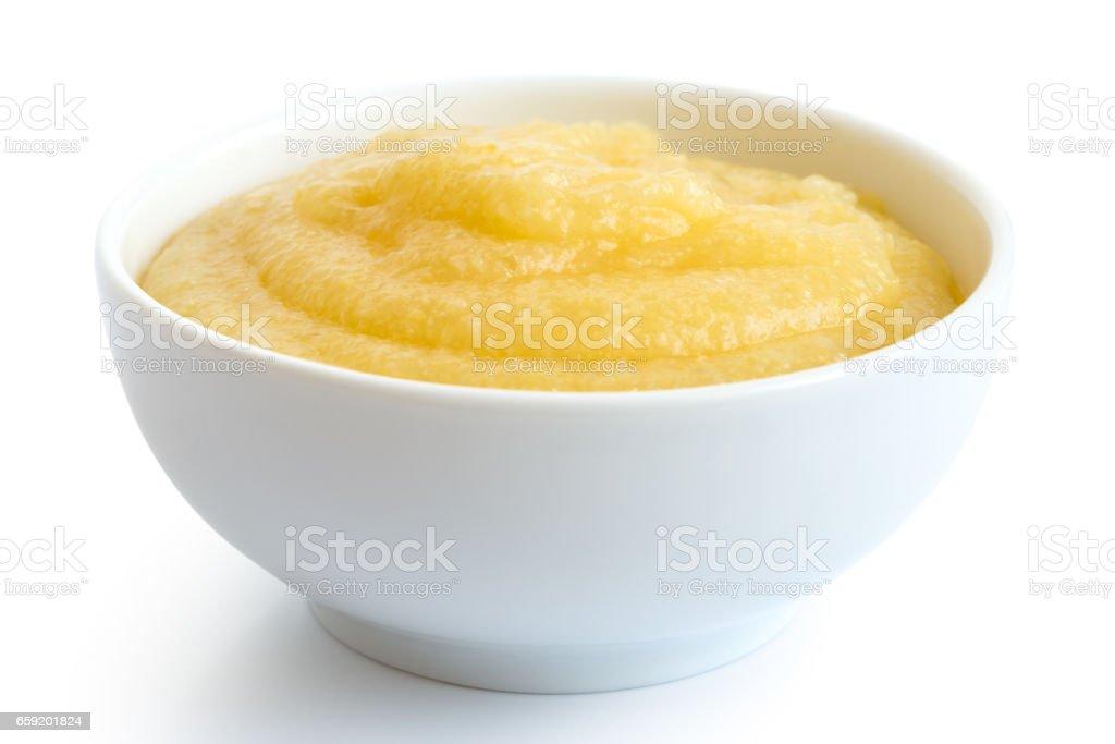 Cooked cornmeal polenta in white ceramic bowl isolated on white. stock photo
