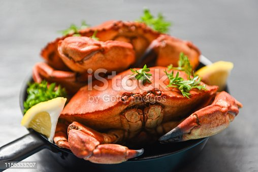 Cooked crab on hot pot and dark background / Seafood boiled red stone crabs