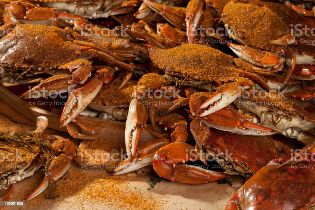 Cooked crabs and Old Bay spices. stock photo