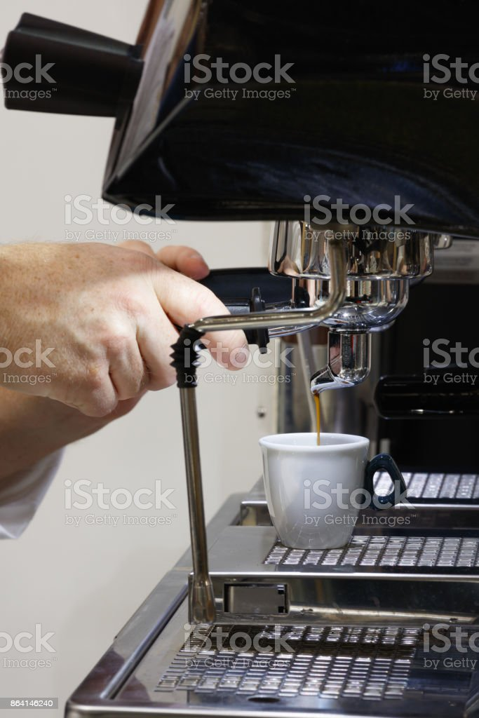 cooked cup of espresso coffee machine is on royalty-free stock photo