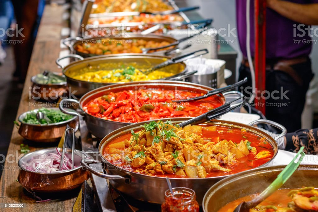 Cooked curries on display at Camden Market in London stock photo