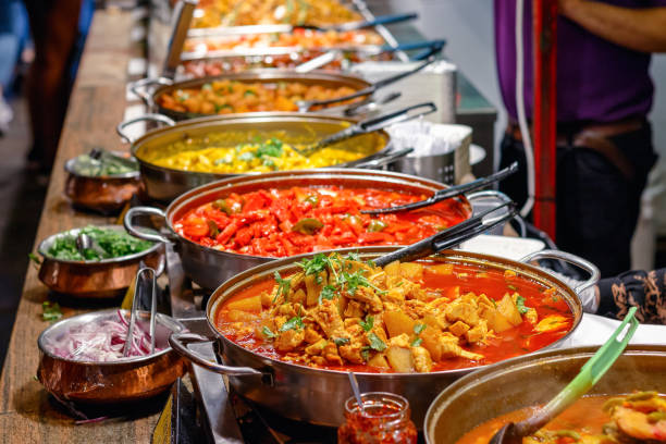 Cooked curries on display at Camden Market in London Variety of cooked curries on display at Camden Market in London exoticism stock pictures, royalty-free photos & images