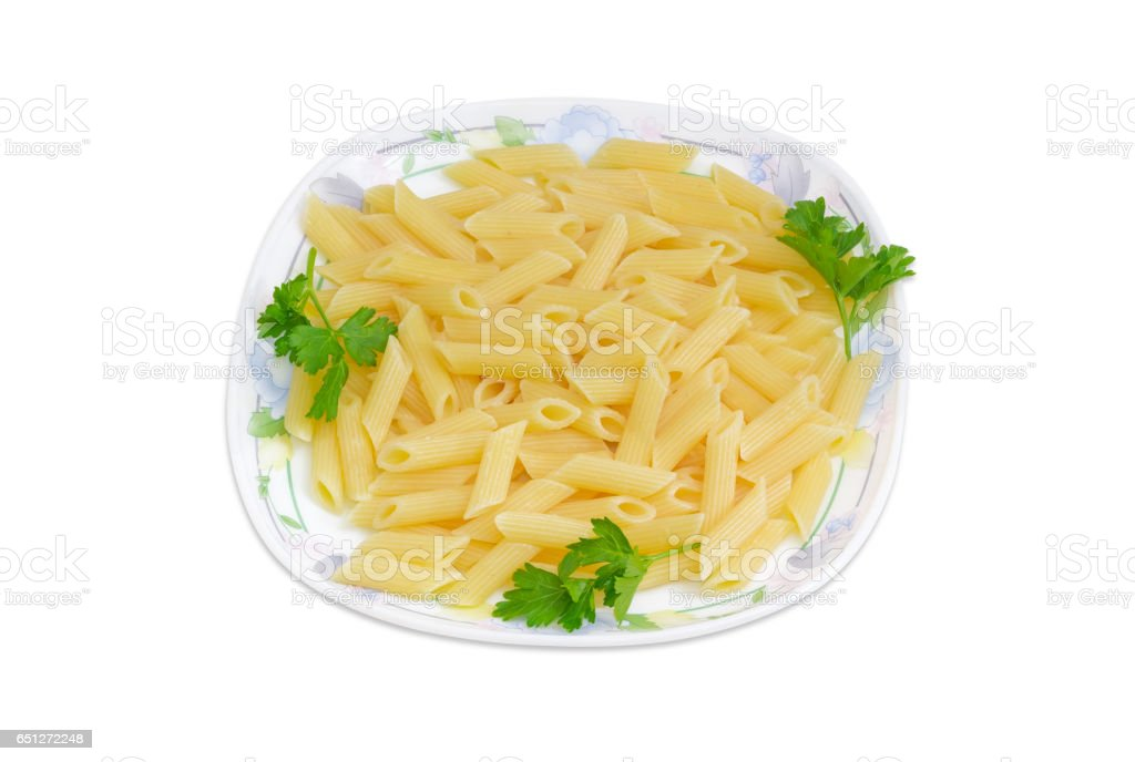 Cooked cylinder-shaped pasta with parsley twigs on a dish stock photo