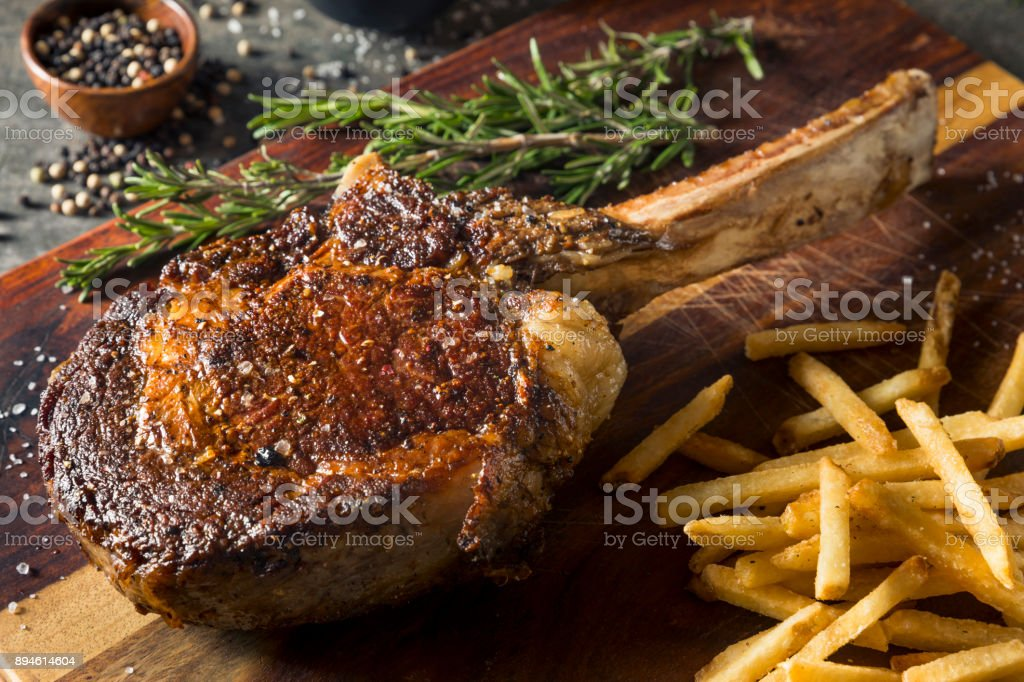 Cooked Grass Fed Tomahawk Steaks stock photo