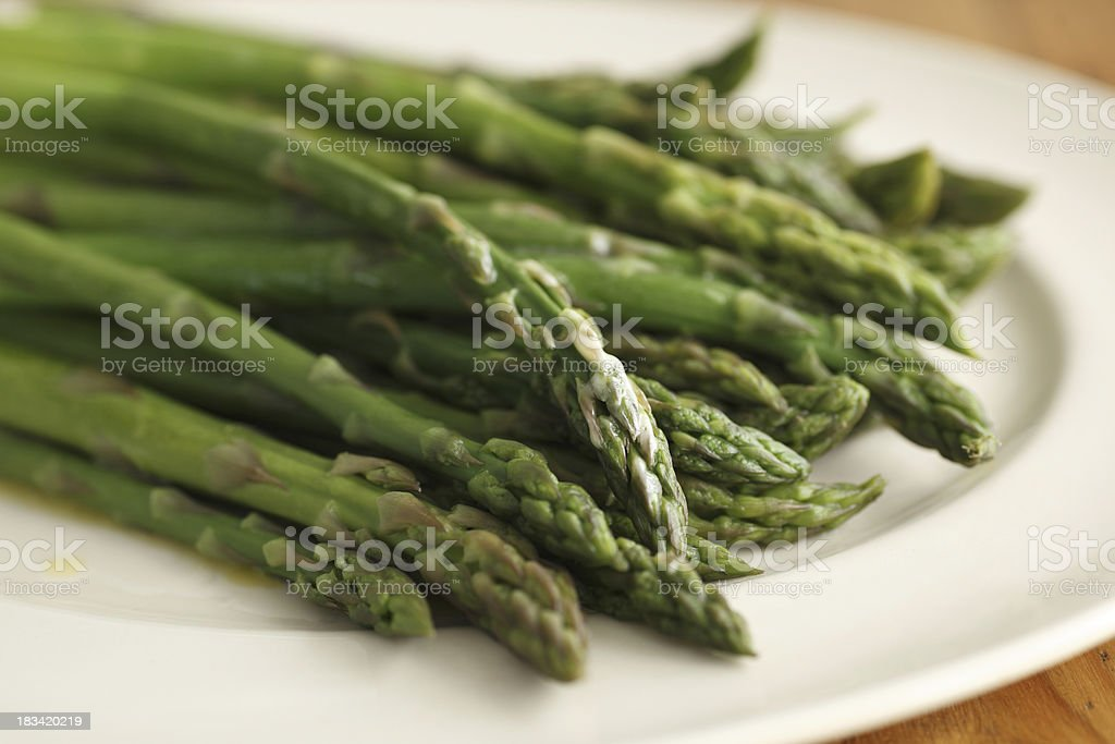 cooked green asparagus stock photo