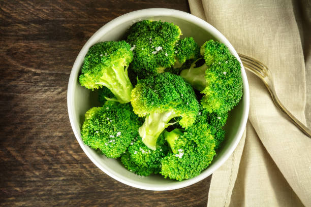 Cooked green broccoli with sea salt and copyspace stock photo