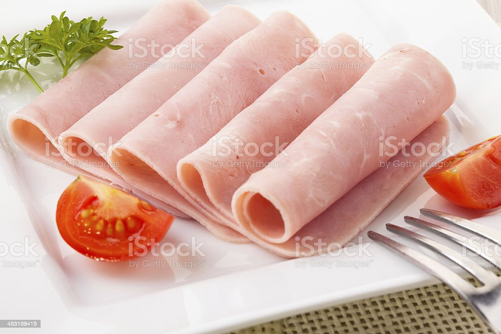 Cooked ham served on a plate royalty-free stock photo