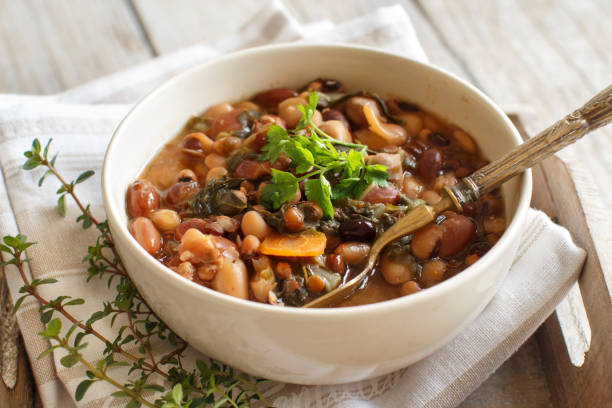 Cooked legumes and vegetables in a bowl stock photo
