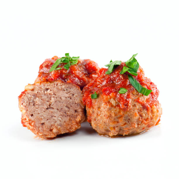 Cooked meatballs with tomato sauce on the white background Cooked meatballs with tomato sauce on the white background meatball stock pictures, royalty-free photos & images