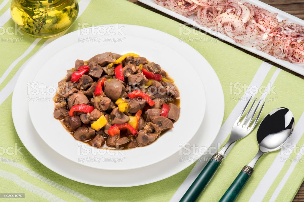 Cooked of kidney saute meal on dinner table stock photo
