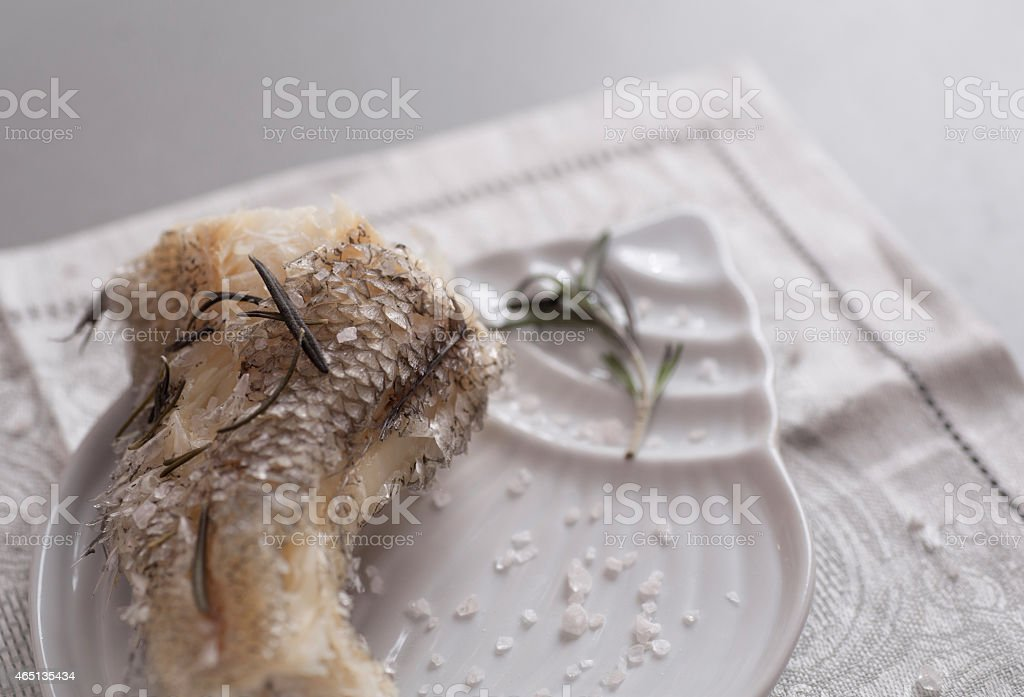 Cooked on steam grenadier fish with sea salt stock photo