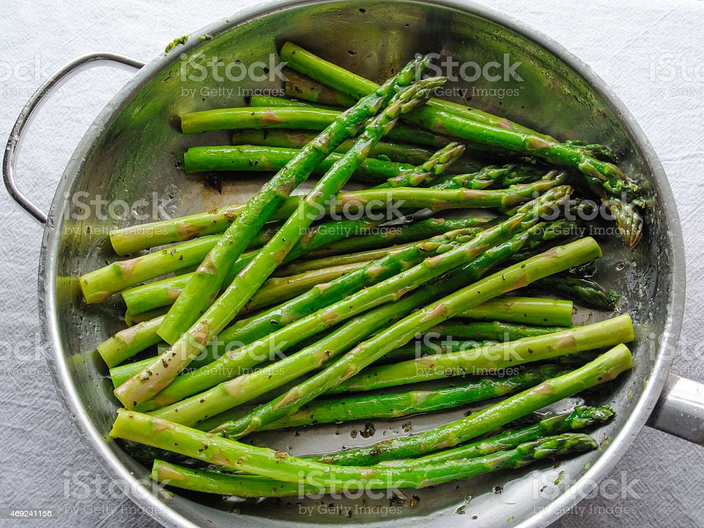 Cooked Organic Asparagus in a Frying Pan stock photo