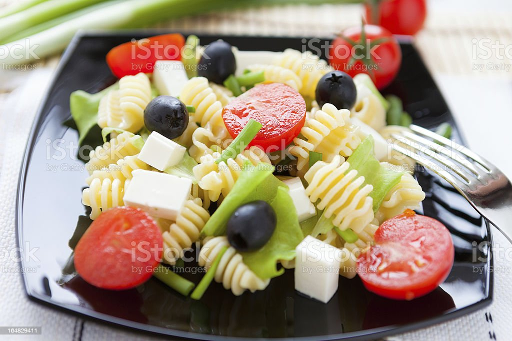 cooked pasta with vegetables and feta royalty-free stock photo
