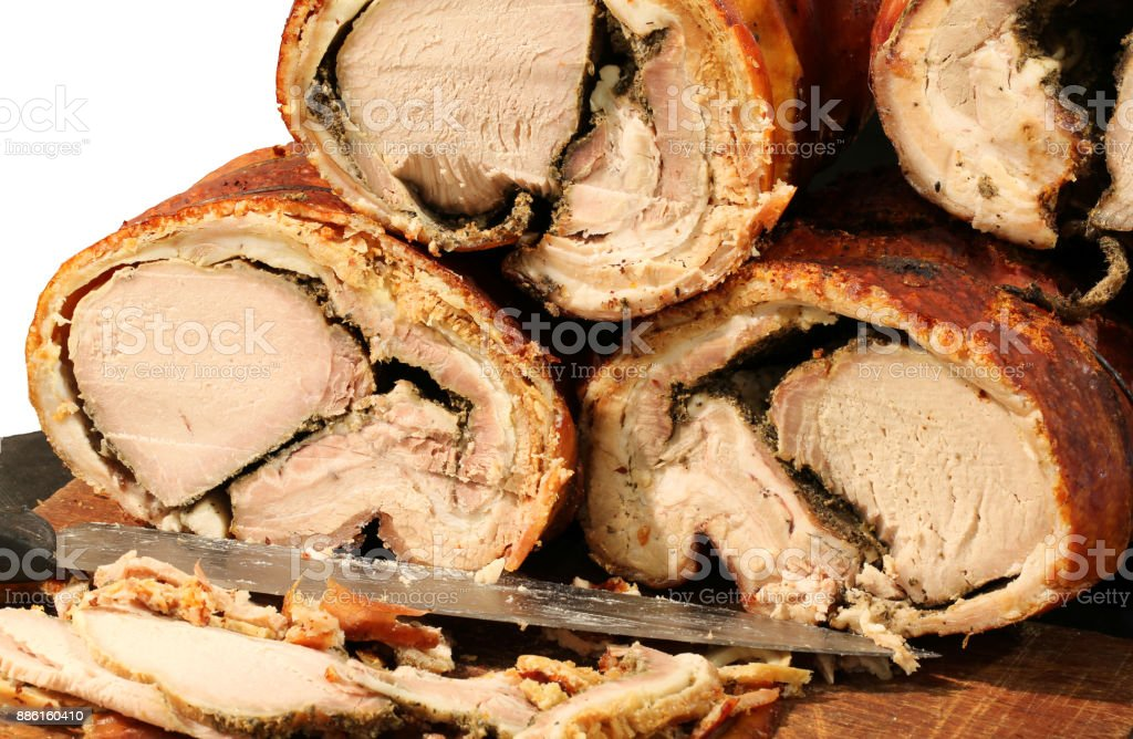 cooked pork meat called PORCHETTA in Italian for sale in the str stock photo