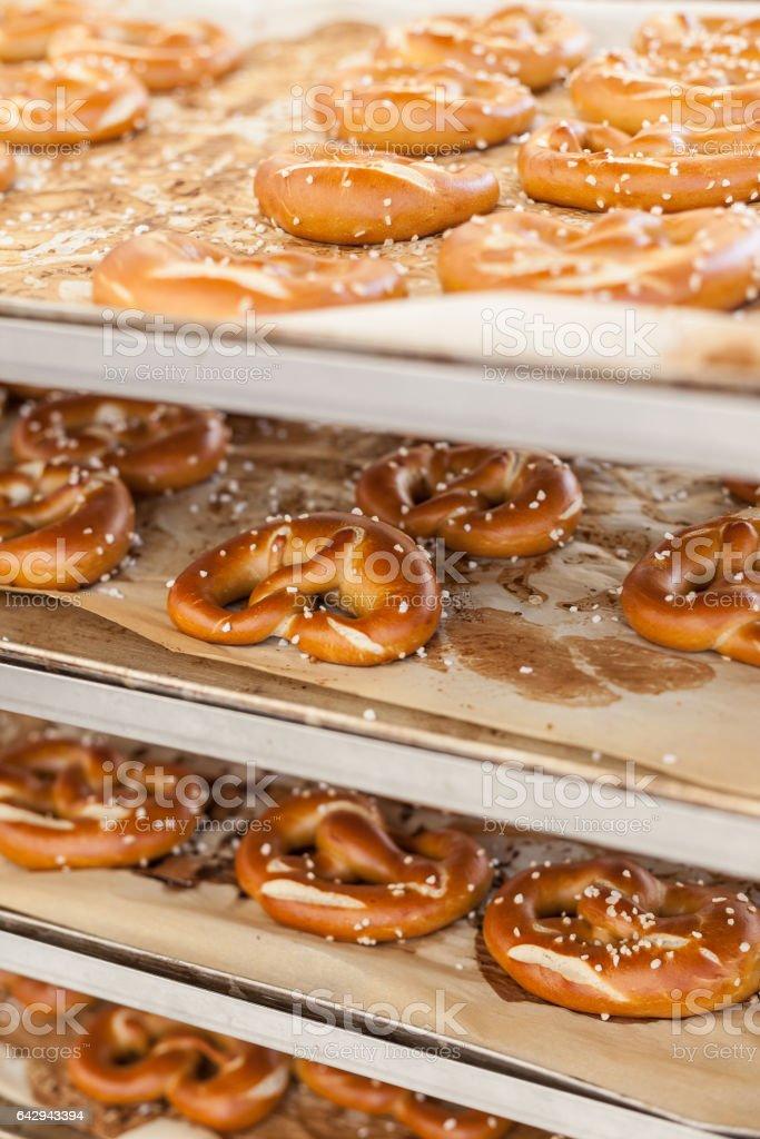 Cooked pretzel on a rack stock photo