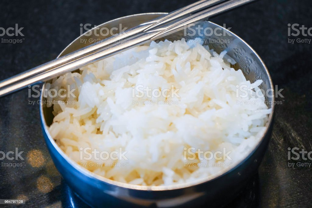 cooked rice in stainless steel bowl royalty-free stock photo