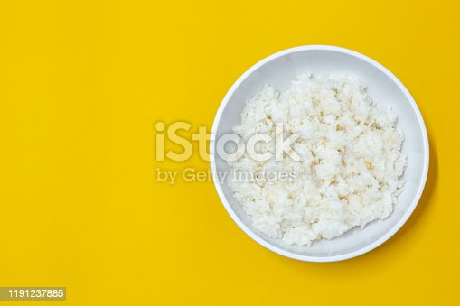 cooked rice on bowl on yellow background