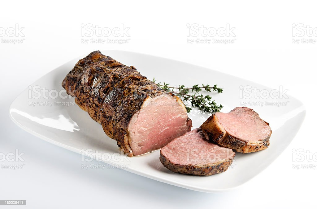 Cooked roast beef on a white plate stock photo