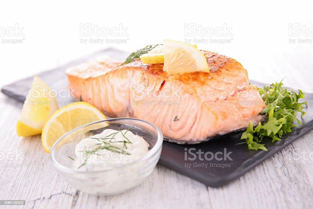 cooked salmon and sauce stock photo