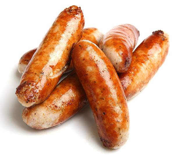 cooked sausage piled together with a white background - sausage stock photos and pictures