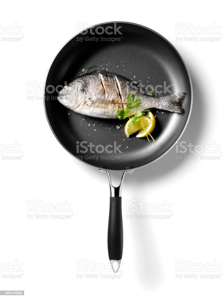 Cooked Sea Bream in a Frying Pan with Lemon stock photo