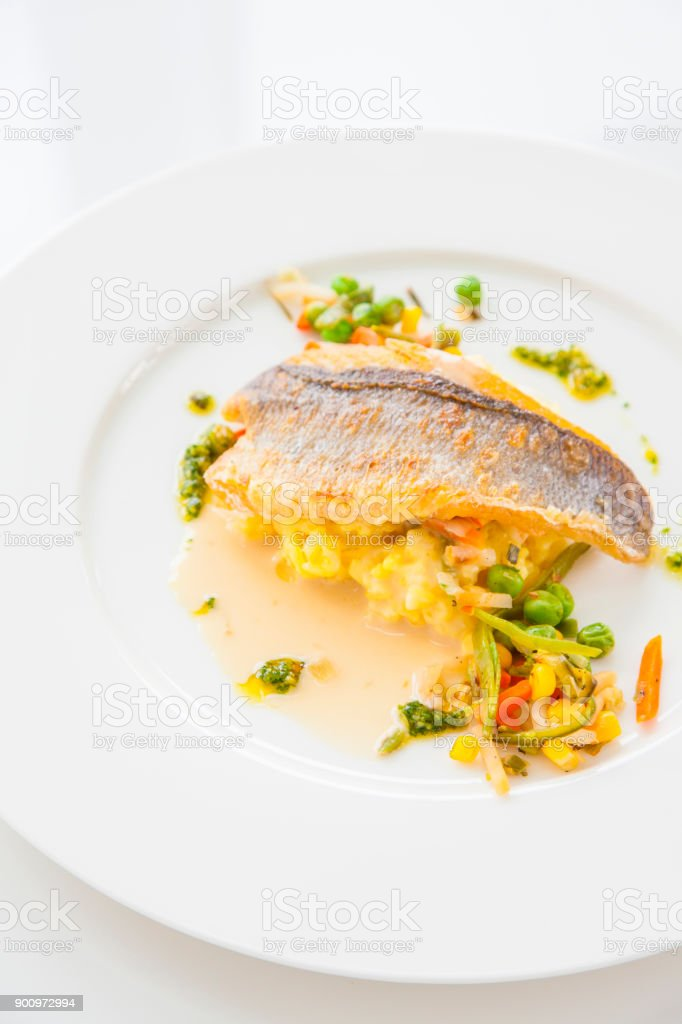 Cooked seabream with risotto stock photo