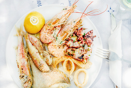 Cooked Seafood On Plate With Lemon And Wine Stock Photo - Download Image Now
