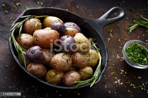 Cooked three colors small potatoes in a cast iron skillet