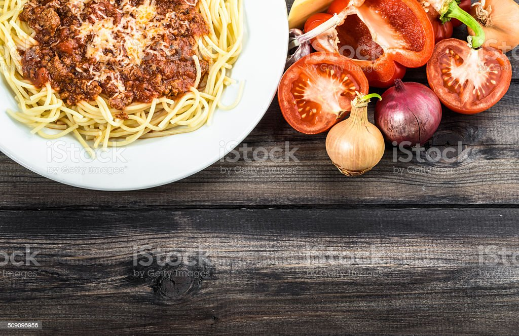 Cooked spaghetti bolognese and ingredients for cooking. stock photo