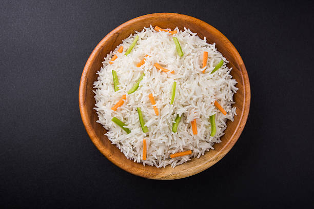 cooked white basmati rice with carrot and capsicum toppings cooked white basmati rice with carrot and capsicum toppings, plain white pulav basmati rice stock pictures, royalty-free photos & images