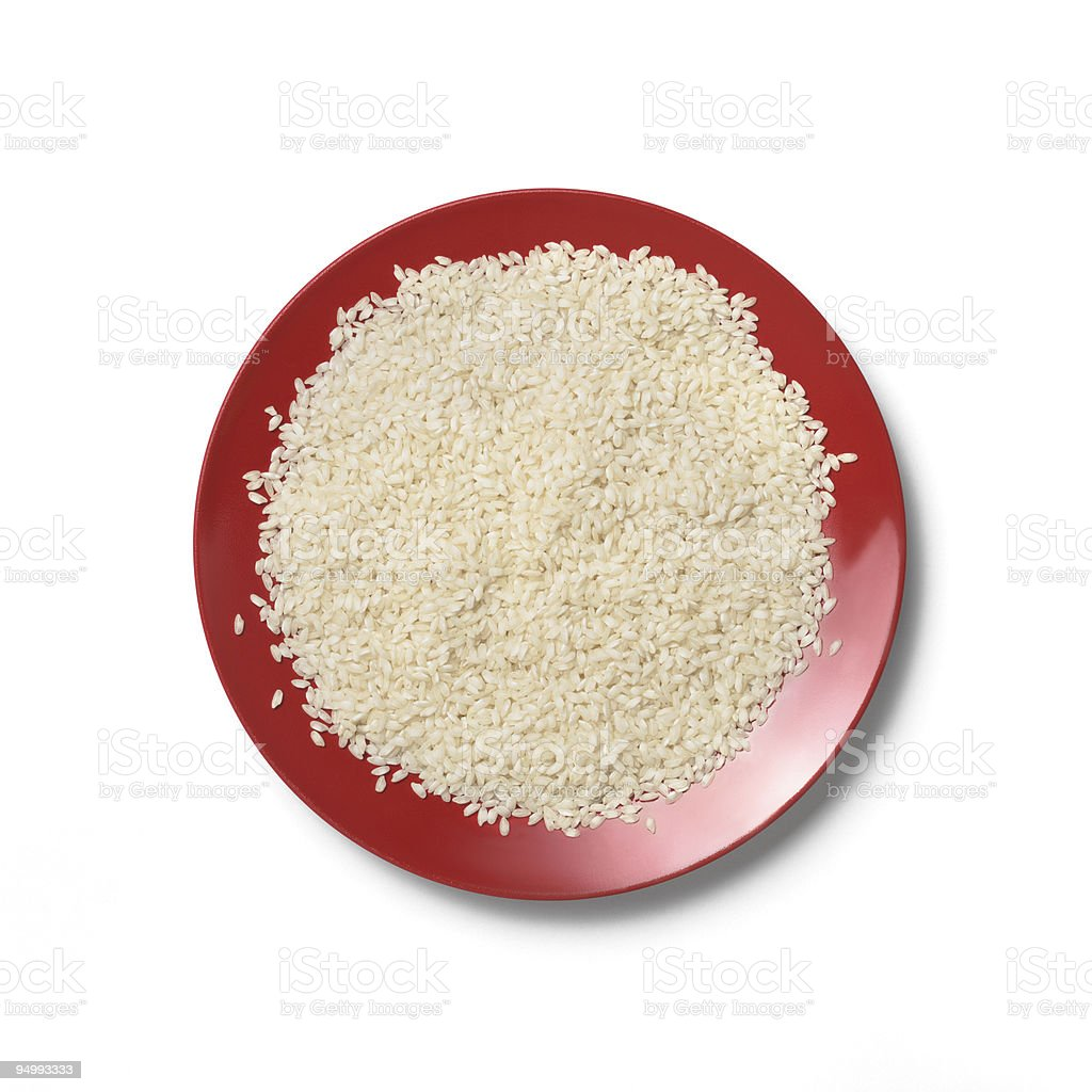 Cooked white rice on a red plate on white background stock photo