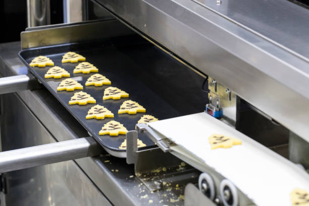 cookie baking automation machine, equipment in bakery industry - depositor stock pictures, royalty-free photos & images