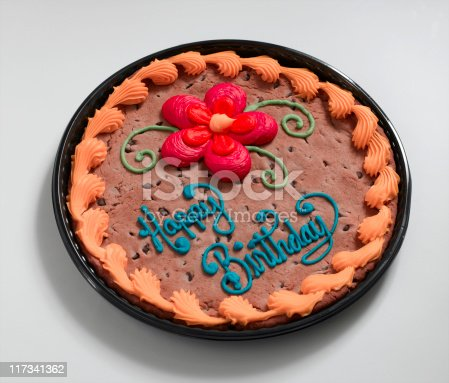 A large chocolate chip birthday cookie.