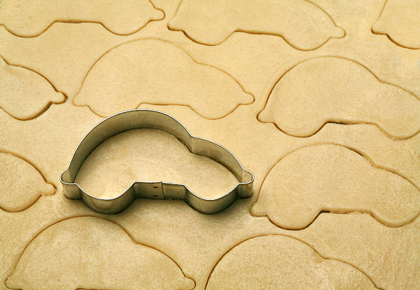 Cookie Cutter Automobile car shaped cookie cutter on dough cookie cutter stock pictures, royalty-free photos & images