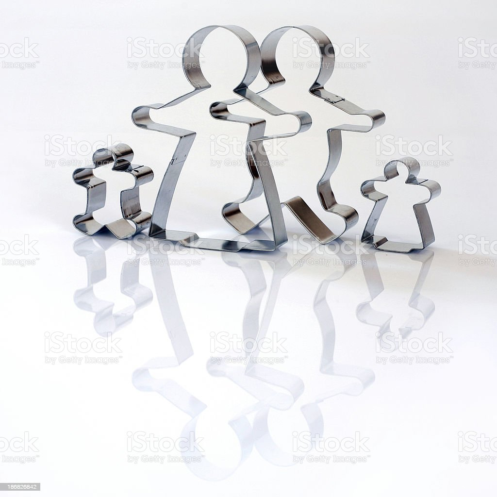 Cookie cutter_gingerbread family stock photo