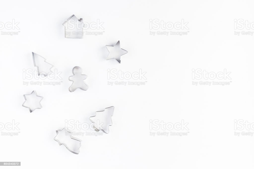 Cookie cutters on white background. Flat lay, top view stock photo
