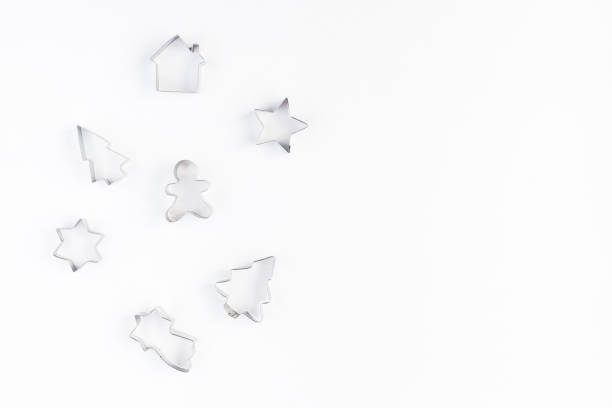 Cookie cutters on white background. Flat lay, top view Cookie cutters on white background. Christmas, winter, new year concept. Flat lay, top view, copy space cookie cutter stock pictures, royalty-free photos & images