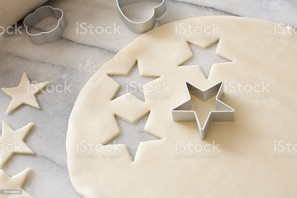 Cookie dough and cookie cutters stock photo