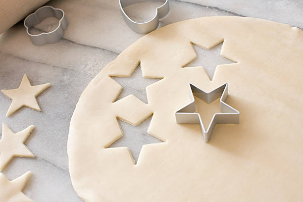 Cookie dough and cookie cutters  cookie cutter stock pictures, royalty-free photos & images