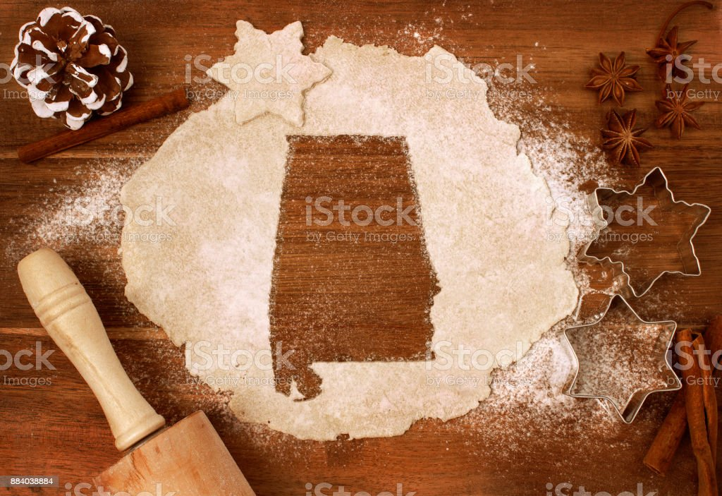 Cookie dough cut as the shape of Alabama (series) stock photo